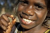 Aboriginal child with an honey ant in Australia ; Warlpiri Aboriginal community of Alice Springs.