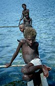 Childs in a little boat New-Ireland Papua New Guinea