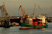 Container ship in the port of Claipeda Lithuania[AT] ; Estuary on the Baltic[AT]