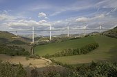 Millau viaduct spanning the Tarn Gorge, southern France. At 336 metres the cable-stayed Viaduc de Millau is the highest bridge in the world and 2.5 kms long. Designed by British architect Sir Norman Foster the viaduct is higher than the Eiffel Tower. Costing 400 millions euros it was competed in December 2004 in 39 months. - Architect Sir Norman Foster