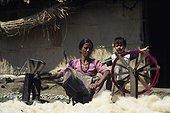 Young woman spinning wool Chitwan NP Nepal