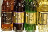 Craft-made syrup bottles Vosges France ; Syrups of Bilberry, Mirabelle plum, Fir tree and Bergamot.
