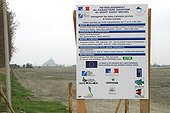 Panel concerning the restoration of mediums Manche France ; With the locality of the Anse de Moidrey, panel announcing work of re-establishment of the maritime character of the Mount-Saint-Michel and relating to the installation of the ponds for the toads punctuated pelodytids. February 2005.