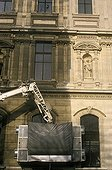 Sanding of the façade of Louvre to clean it Paris France