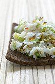 Slice of bread with cold fish with the relish France