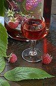 Liquor glass of raspberry and bottle Pontarlier France
