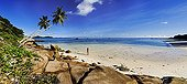 Tropical beach and coconut trees La Digue Island Seychelle ; Voted by the London Sunday Times as the world's best beach.<br>