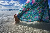 Woman walking on a tropical beach Frigate Island Seychelle ; @ Frigate (Island)