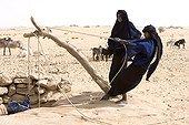 Tuareg women drawing  water of the well Desert of Tenere
