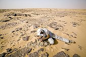 Paleontologist releasing the fossil of a Sarcosuchus Niger ; Researcher: Jean-Sebastien Steyer of the National Natural History Museum (MNHN)<br/>Site : Gadoufaoua