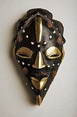 African mask from Nigeria ; Coin mask to celebrate wealth.
