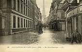 Street under water and Eiffel Tower Flood of Paris in 1910 ; Support : old postcard.