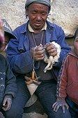 Man spinning wool Mustang Nepal
