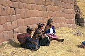 Women in traditional clothe spinning wool Peru
