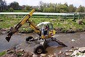 Pipes of factory and excavator Liberec Czech Republic ; Region : Liberec