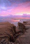 Sunrise on the red rocks of the beach Brazil
