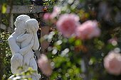 Roses and statue Rose garden Belfort France