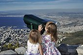 City girl watching with binoculars South Africa