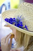 Straw hat with blue flowers
