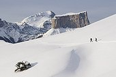 Snowshoeing in the Vercors Isère France ; View on the Mont Aiguille.