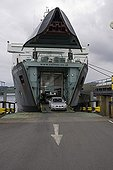 Car going down from the bow of a ferry on Islay island UK ; Bow doors opening and cars leaving Calmac ferry Port Ellen Isle of Islay