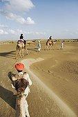 Tourists on a camel safari India