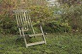 Old wooden armchair at Jardin de Elsie in autumn
