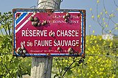 Hunting reserve sign covered with snails Ré island France