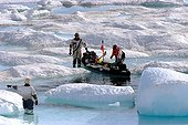 Hauling of kayak on the ice melting in summer Arctic ; <br><br>