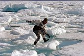 Man jumping on a stable plate of Arctic sea ice ; <br><br>