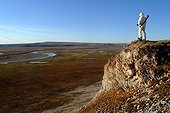 Man seeking the presence of musk oxes Arctic ; <br><br>
