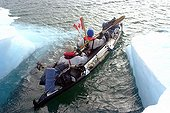 Progression in kayak among icebergs Arctic ; <br><br>