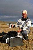 Man in the Arctic with a satellite phone ; @ Autonomy<br><br>