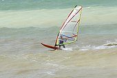 Windsurfing boarder spinning on the water Pourville France