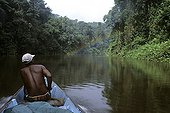 Man on canoe on a river in the rainforest French Guiana