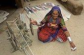 Indian woman of minority Bishnoï spinning cotton Jodhpur