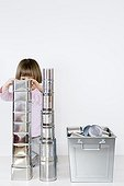Girl playing to build a cans stack