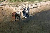 Boat wrecks on a beach of the Ile d'Arz France