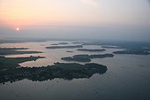 Sunset on the islands of the Morbihan's gulf France ; From Gavrinis Island to the Ile aux moines.