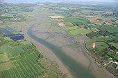 Flight in paramotor above the Penerf river France ; @ Paramotor