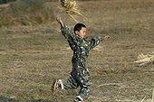 Moso boy fun to run in Yunnan ; Location: near Lake Lugu