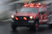 Ambulance traveling at high speed in the city Quito Ecuador  ; Photo taken in slow speed. Effect of movement.