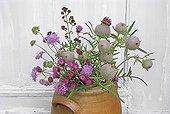Bouquet of purple flowers in a earthen pot France