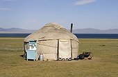 Yurt near lake Son Kul in Kyrgyzstan ; Yurt equipped with a sink, a milk can and dishes.