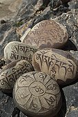 Stones engraved of mantra in Zangla Village India ; The mantra is an object or support of meditation. The inscribed on these stones is: om mane padme hum. <br>