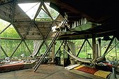 Brazilian hammock in a green house Ariège  ; The house is shaped like a geodesic dome