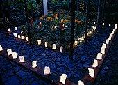 Candles and cannas at Jardin des paradis