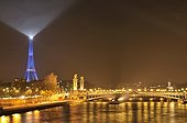 Paris under the mist and illuminated Eiffel Tower France