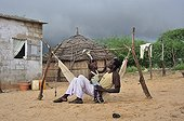 Fulani men and children in a hammock Senegal