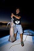 Sport Fisherman with Jumbo Squid, Humboldt Squid, Hand Caught at Night, Santa Rosalia, Sea of Cortez, Baja California, East Pacific, Mexico